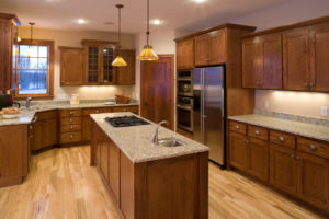 Custom kitchen with oak cabinetry, maple floors, granite counter-tops and stainless steel appliances.